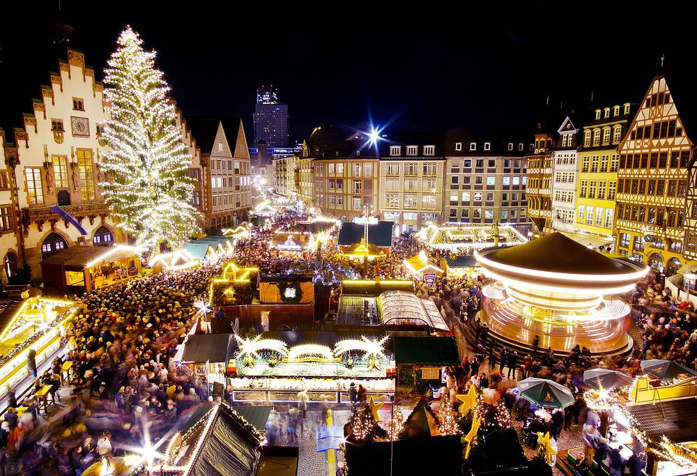 A merry-go-round turns as the Christmas tree is illuminated after the opening of the traditional Christmas market in Frankfurt, November 26