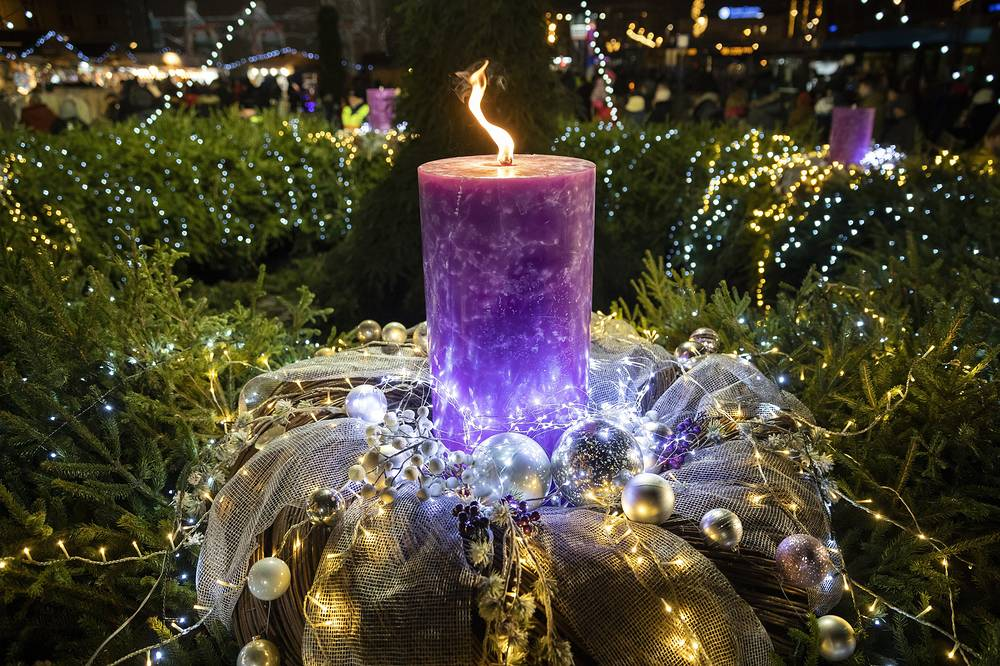 A huge candle burns on the Advent wreath at the Christmas market titled 'Advent Feast at the Basilica' in front of St. Stephen Basilica downtown of Budapest