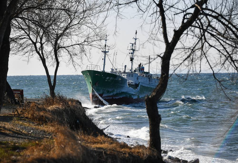 A North Korean fishing vessel anchored in the Amur Bay drifts towards the shore near Cape Kungasny due to strong gusts, December 7