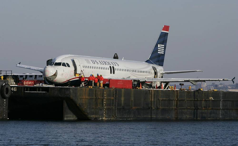 Inspectors examine items removed from US Airways Flight 1549 as it sits on a barge at Weeks Marina, January 20, 2009