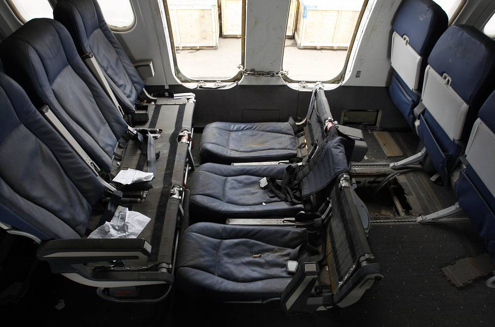 The moldy and damaged interior of the wreckage of US Airways flight 1549, 2011