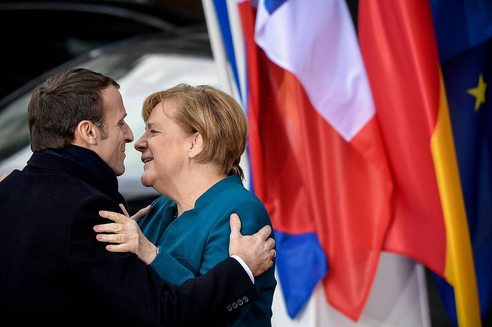 German Chancellor Angela Merkel and French President Emmanuel Macron arrive for the signing of a new Franco-German friendship treaty in Aachen, Germany, January 22