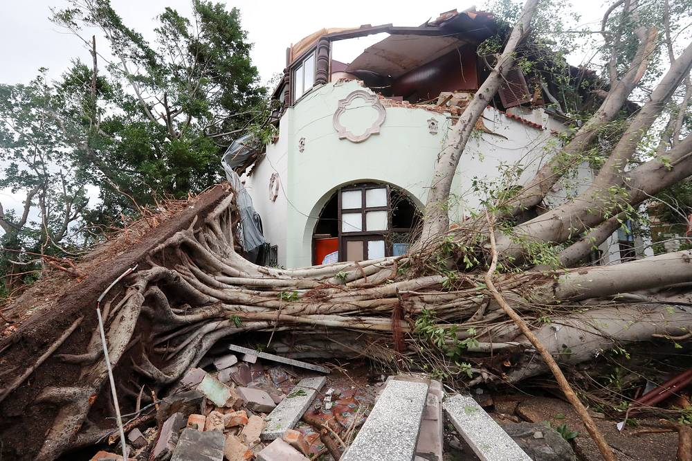 View of a house partially destroyed by fallen trees upon a tornado in Havana, January 28