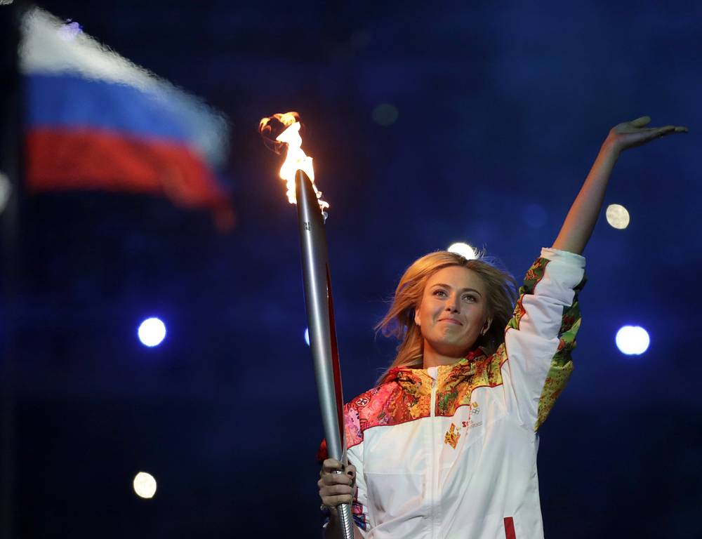 Russian tennis player Maria Sharapova carrying the Olympic torch during the opening ceremony of the 2014 Winter Olympics