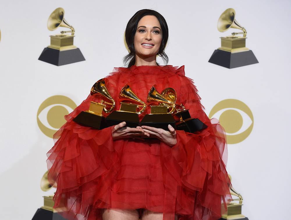 """Kacey Musgraves, winner of the awards for best country album for """"Golden Hour"""", best country song for """"Space Cowboy"""", best country solo performance for """"Butterflies"""" and album of the year for """"Golden Hour"""""""