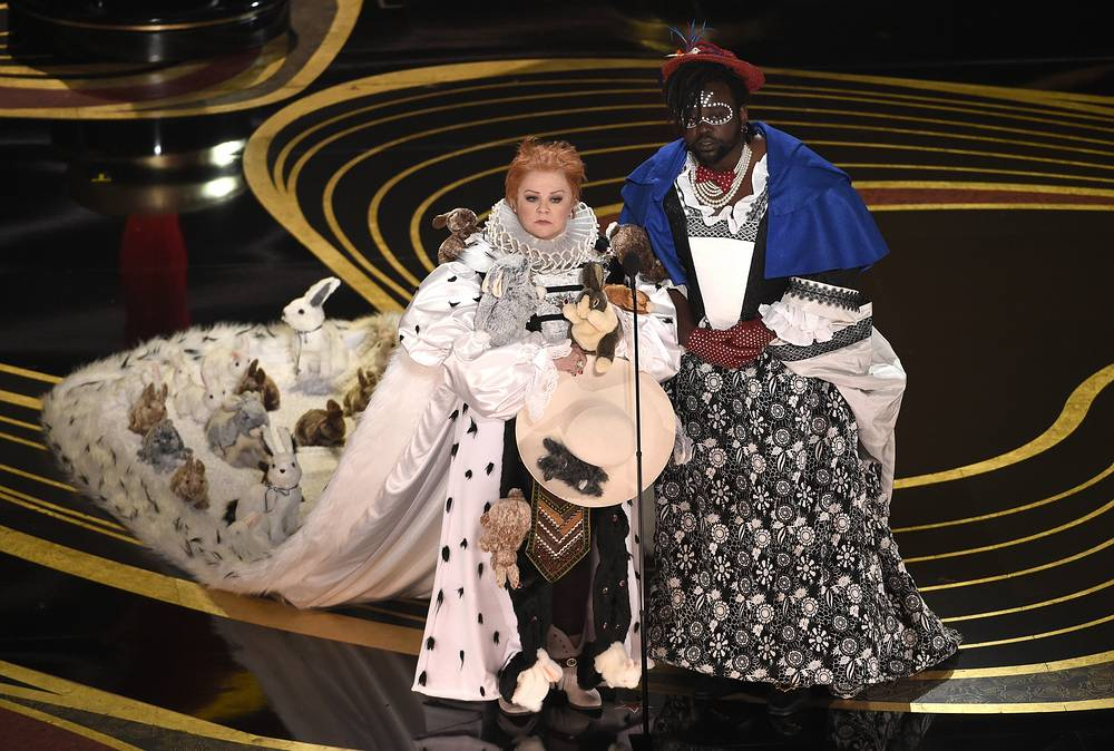 Melissa McCarthy and Brian Tyree Henry present the award for best costume design
