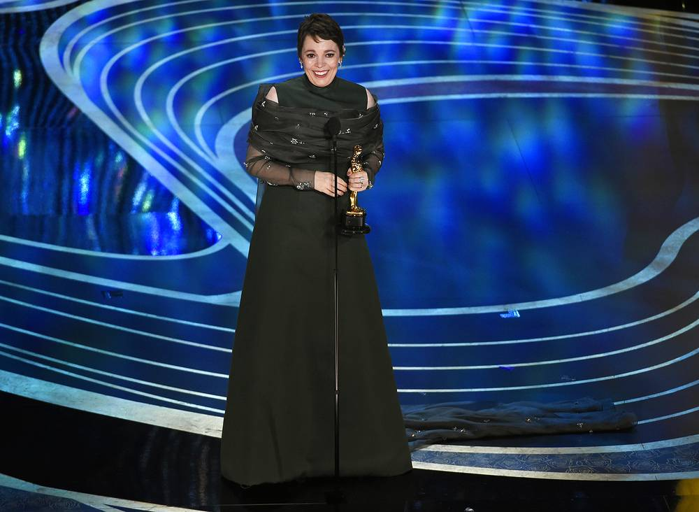 """Olivia Colman accepts the award for best performance by an actress in a leading role for """"The Favourite"""""""