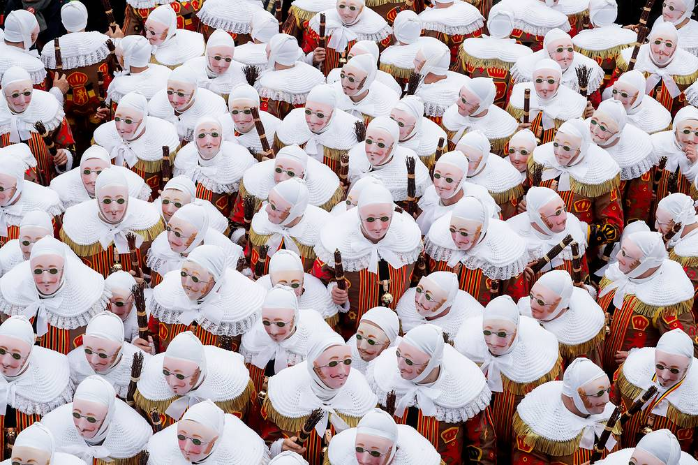 Festival participants known as 'Gilles', wearing traditional costumes, during Carnival celebrations in the streets of Binche, March 5. The Carnival de Binche is a popular historical cultural event that was named a Masterpiece of the Oral and Intangible Heritage of Humanity by UNESCO in 2003