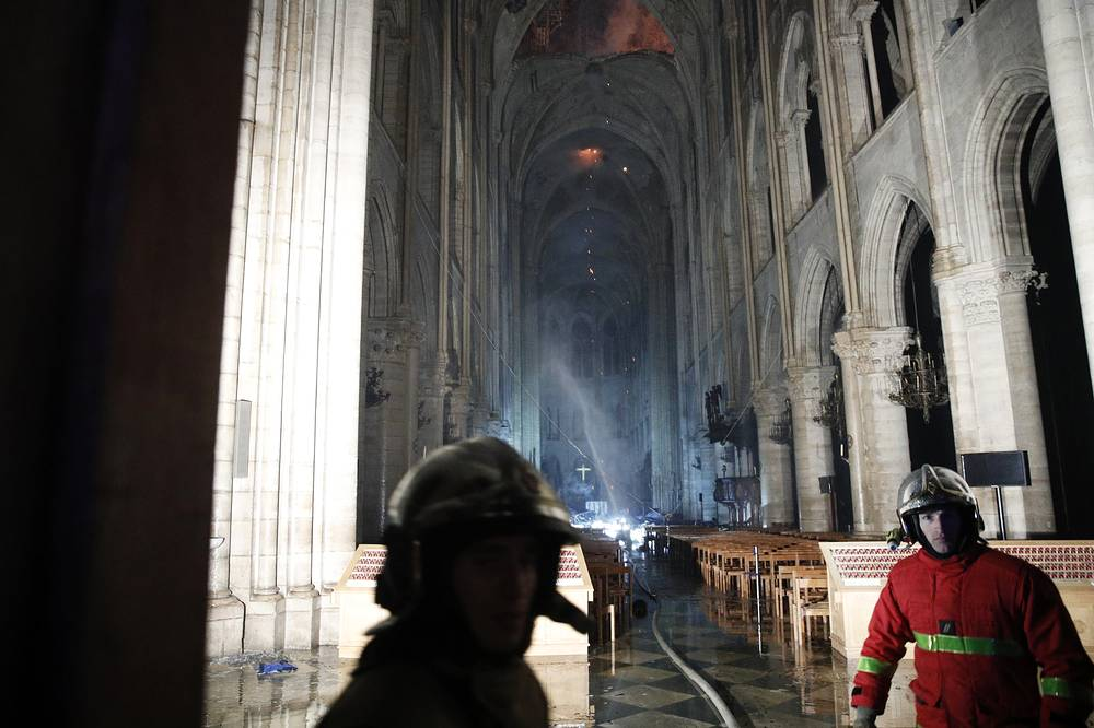 French firemen entering the Notre-Dame Cathedral