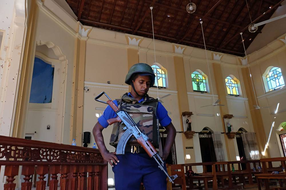 A police officer standing guard in Katuwapitiya St. Sebastian church in Negombo near Colombo