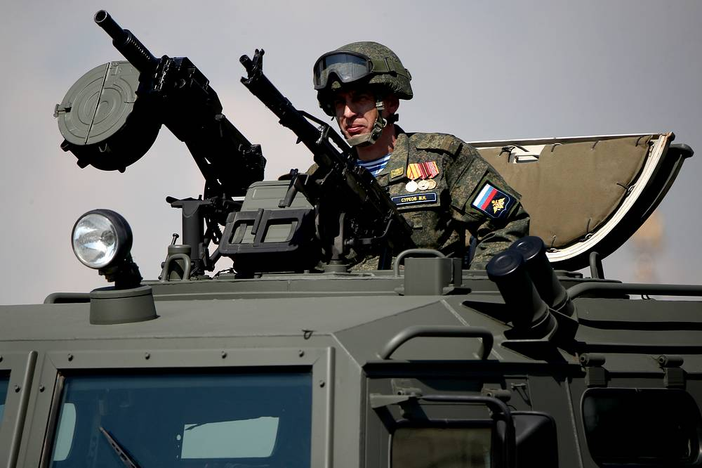 A serviceman in a Tigr-M armoured vehicle