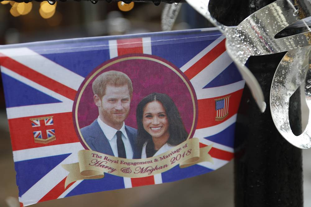 A flag depicting Britain's Prince Harry and his wife Meghan, Duchess of Sussex hanging near Windsor Castle
