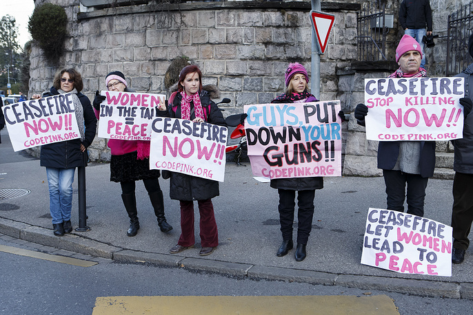 Members of movement Codepink women for the peace protest near the hotel, during the opening of the Geneva II peace talks, in Montreux