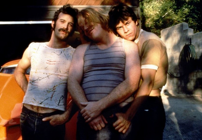 """A close friend of Paul Thomas Anderson, Hoffman starred in almost all of his films. Photo: scene from """"Boogie Nights"""" featuring Hoffman (center)"""