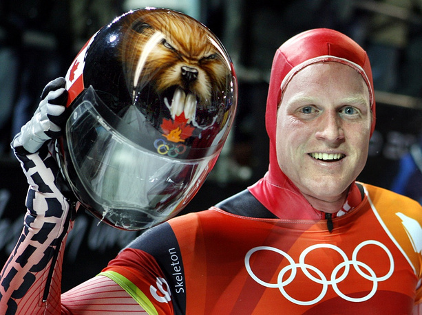 It's quite common to decorate the headgear with images of animals. Photo: Jeff Pain shows his helmet after the Olympic Men's Skeleton race at the Turin 2006 Winter Olympic Games