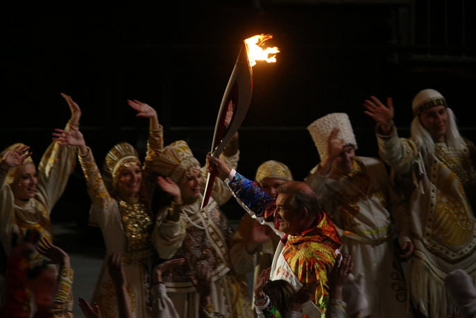 Vladislav Tretyak with the Olympic flame during the opening ceremony