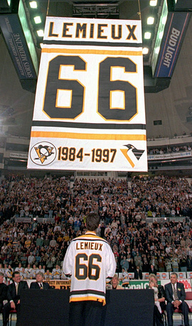 Former Pittsburgh Penguins' Mario Lemieux watches as a banner is raised honoring him during a ceremony retiring his number before the game against the Boston Bruins in Pittsburgh on Wednesday, Nov. 19, 1997