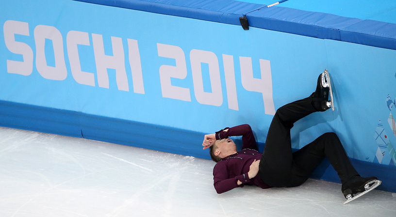 Jeremy Abbott of the USA falls during his performance during the Men's Short Program in figure skating