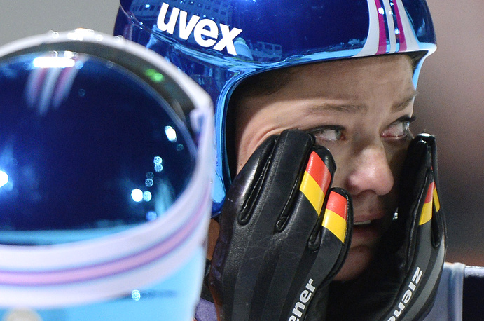 Some athlete can't hold their tears. Photo: Carina Vogt of Germany after winning the gold medal in the Ladies' Normal Hill Individual competition