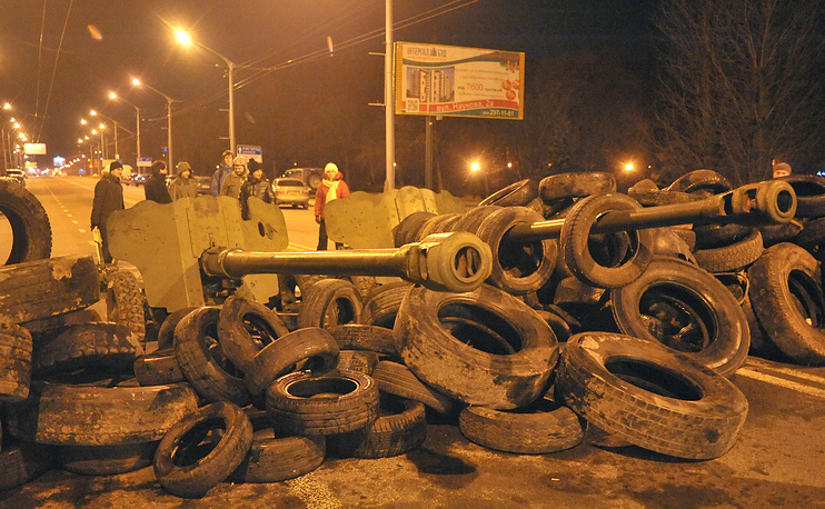 A barricade made from old tires and two cannons, captured in a local military unit in west-Ukrainian city of Lviv