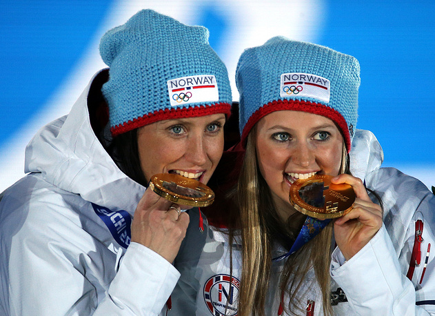 Most athletes can't believe it's true and they bite the medal to check if it really is gold. Norway's Marit Bjoergen (L) and Ingvild Flugstad Oestberg pose with their medals