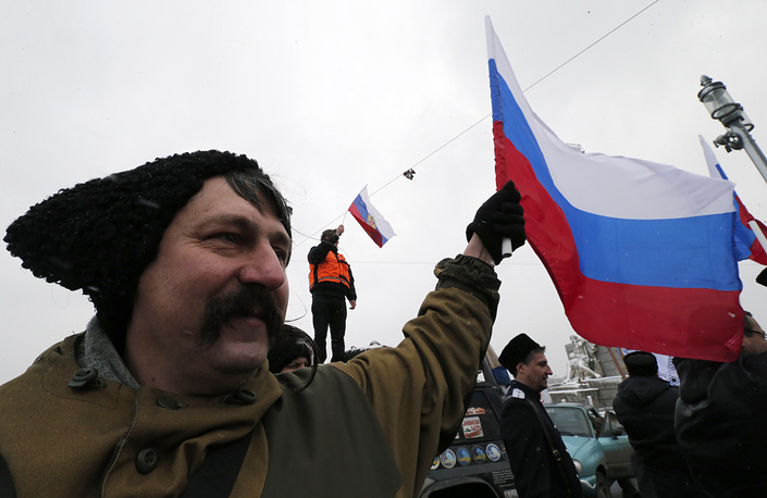 Russian Cossacks wave the national flags