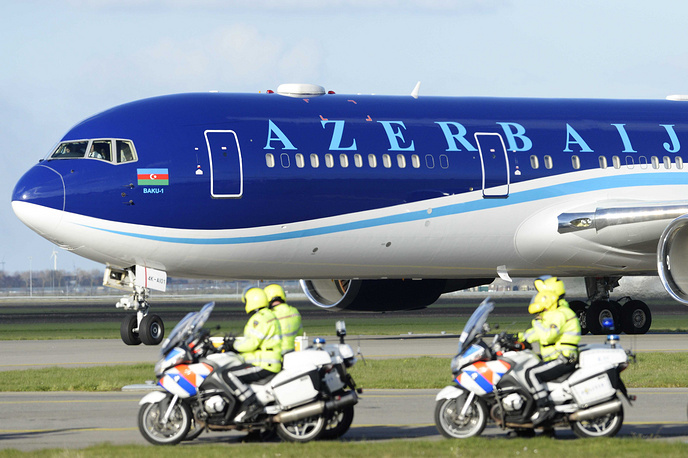 Law enforcers patrol as the plane carrying President Ilham Aliyev of Azerbaijan arrives at Schiphol Amsterdam Airport