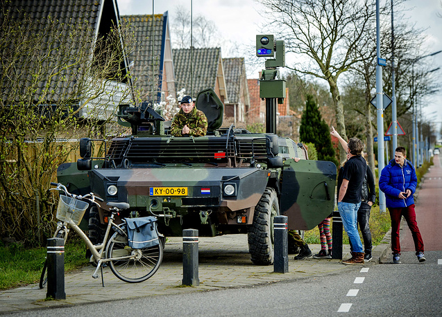 A military observation vehicle guards intersections and driveways