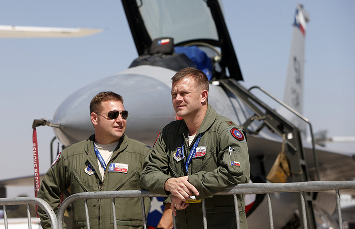 US pilots talk in front of an aircraft