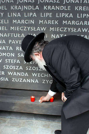 Belzec in Poland was the site of the first of the Nazi German death camps. Photo: an old Israeli put a candle light at the Memorial Site in the Belzec death camp