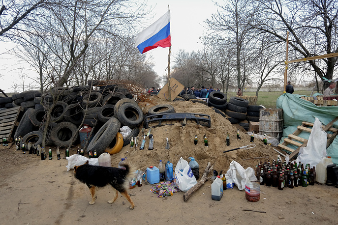 Pro-Russian protesters build a barricade in front of air base entrance in Kramatorsk