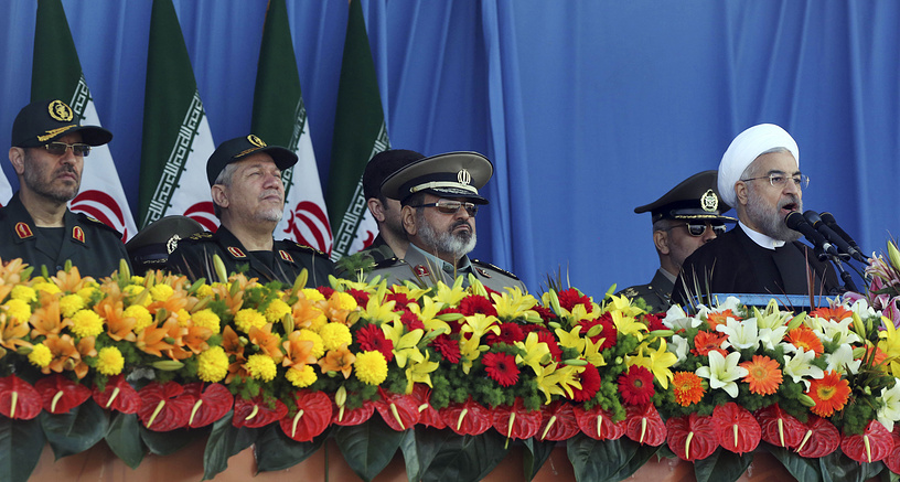 Iranian President Hassan Rouhani makes a speech during the parade