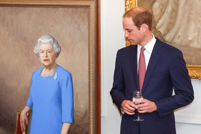 Britain's Prince William, Duke of Cambridge attends the unveiling of a new portrait of British Queen Elizabeth II on April 10, 2014