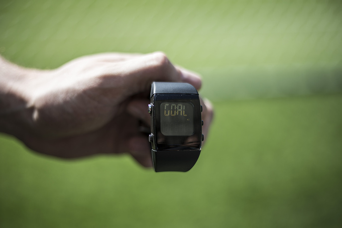 A Fifa official holds up a digital watch for the World Cup referees reading 'Goal'
