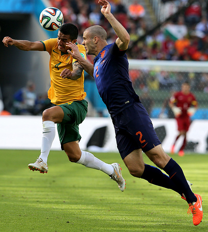 Tim Cahill of Australia (L) and Ron Vlaar of the Netherlands in action during the FIFA World Cup 2014 group B preliminary round match between Australia and the Netherlands