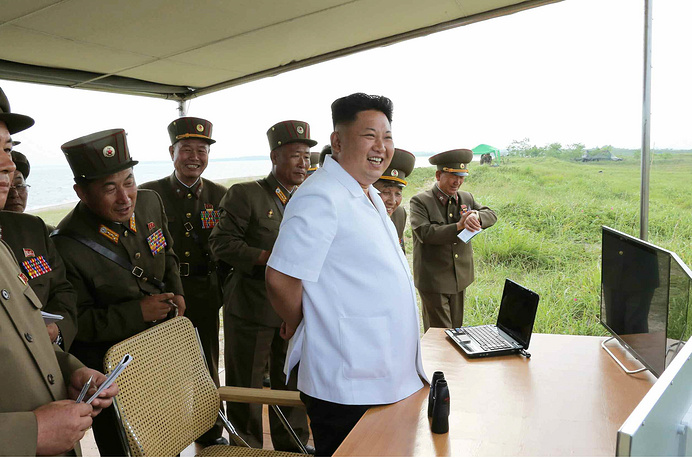 North Korean leader Kim Jong-un observing the test-fire of a newly developed tactical guided missile