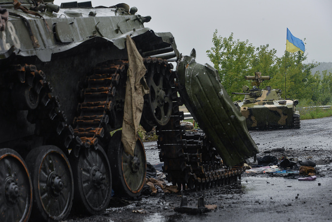 A military tank of the militia stands destroyed in Sloviansk