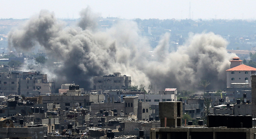 Smoke rises after an airstrike by Israeli forces in the south of Gaza City