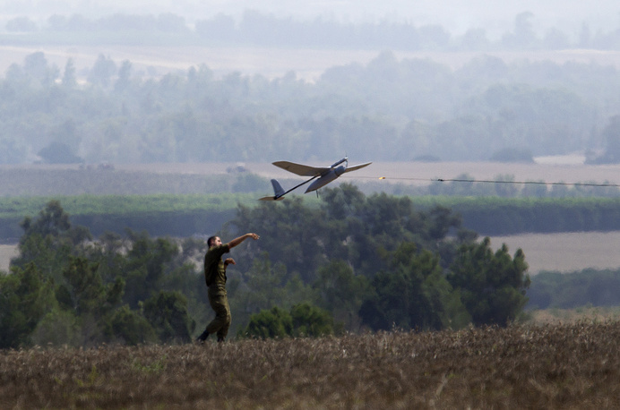 An Israeli soldier launches an unmanned drone aircraft