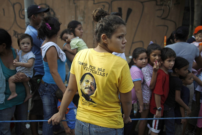 A girl wears a T-shirt featuring Nicaragua's President Daniel Ortega in 2011