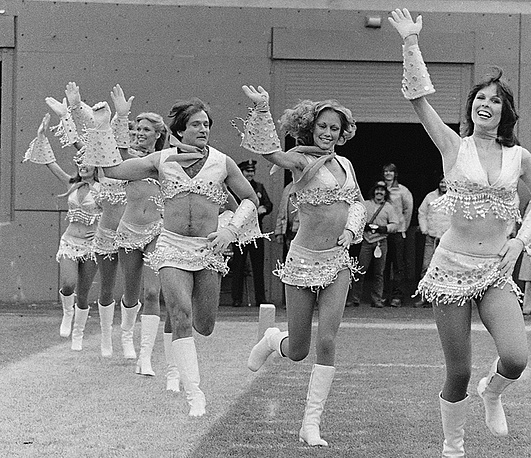 Robin Williams, third from right, dressed as a cheerleader with the Broncos' Pony Express cheerleaders during the filming of an episode of 'Mork & Mindy'