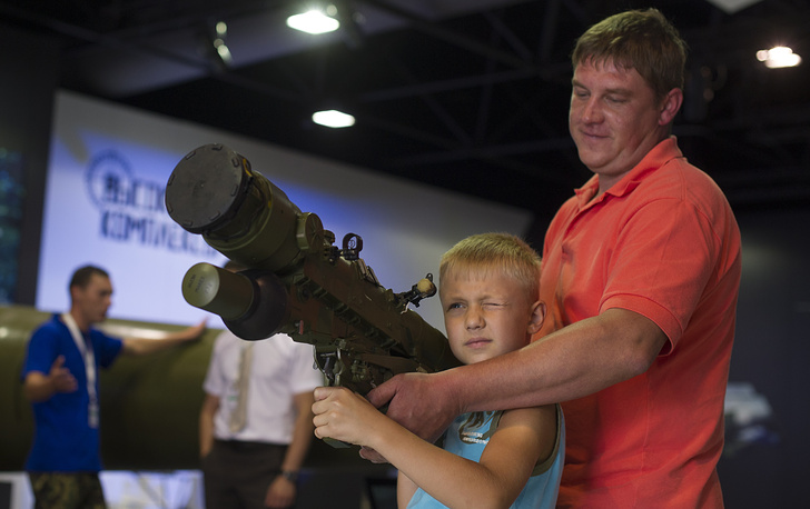 A father and his son visit the exhibition