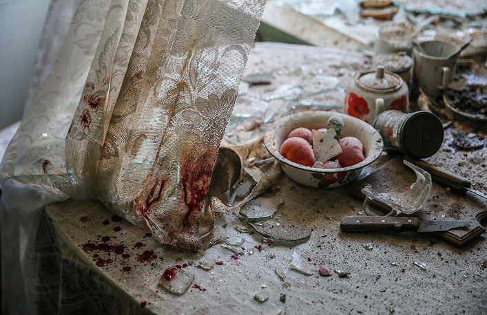 View of a kitchen in a house destroyed in a shelling attack, Donetsk
