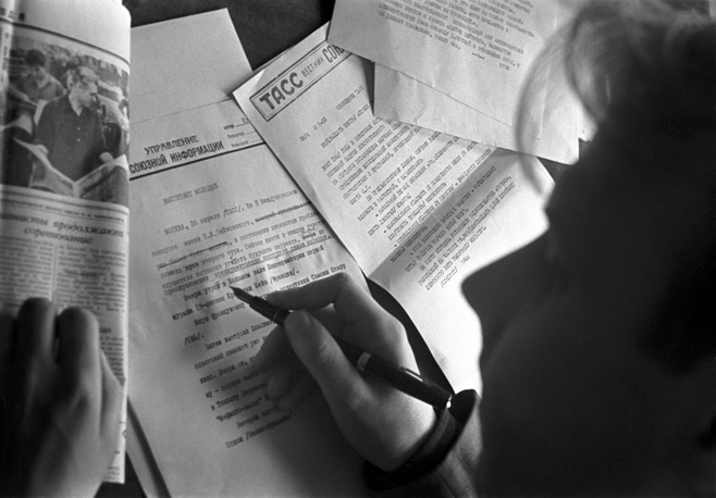 A journalist prepares an article for publishing, 1962