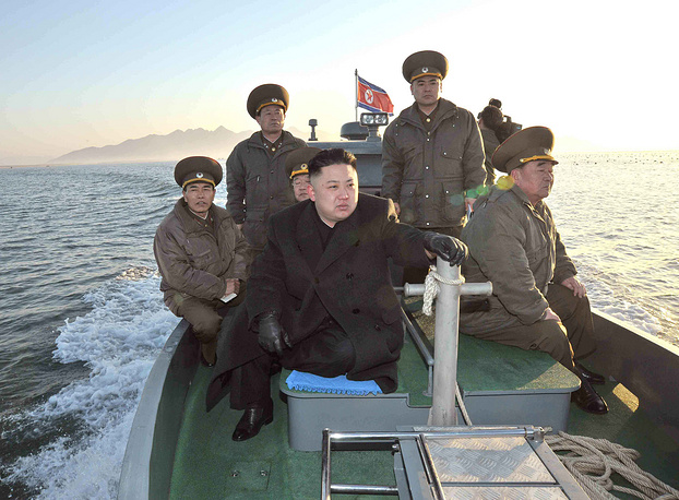 Photo: Kim Jong Un rides on a boat, North Korea, near the western sea border with South Korea, photo released March 11, 2013