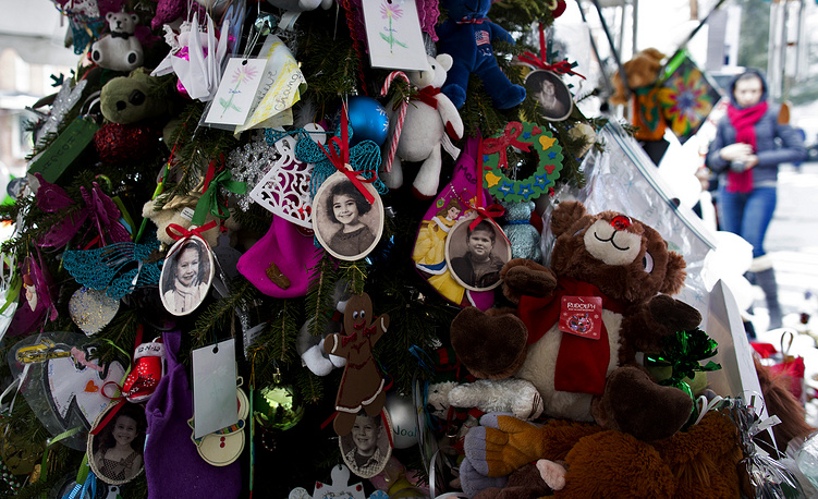 The shooting prompted renewed debate about gun control in the United States. Photo: Portraits of slain students and teachers hang from a tree at a memorial in Newtown