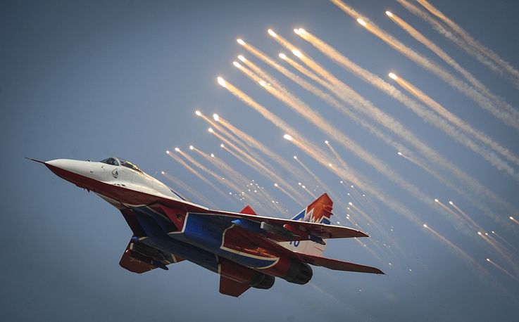 Photo:  A MiG-29 jet fighter of the Swifts aerobatic team performs a demonstration flight at an air show on the Russian Air Force Day