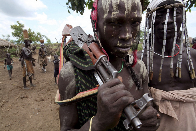 Photo: A man from the Mursi tribe in southern Ethiopia carries his Kalashnikov rifle