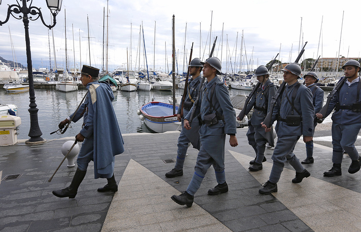 Photo: French citizens wear World War I infantry uniforms in a parade during an Armistice Day ceremony in Nice, France, November 11, 2014