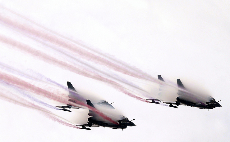 Photo: China's August 1st Aerobatics Team performs a demonstration flight at Airshow China 2014